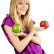 Young beautiful woman holding two apples — Stock Photo