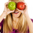 Funny girl holding two apples - Stock Photo