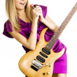 Royalty-Free Stock Photo: Young lady playing an electric guitar