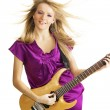 Royalty-Free Stock Photo: Hot girl playing an electric guitar