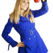 Girl in blue coat holding an apple — Stock Photo