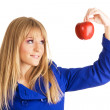 Girl in blue coat holding an apple — Stock Photo #5726500