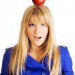 Funny young woman with an apple on her head — Stock Photo #5726503