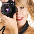 Cheerful young woman taking a picture — Stock Photo