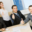 Successful business team showing thumbs up — Stock Photo #5726862