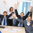 Foto Stock: Joyful business team in office