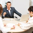 Financial adviser and his customers — Stock Photo