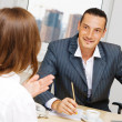 Professional advisor having a discussion with a customer — Stock Photo