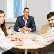 Financial adviser and his customers — Stock Photo #5726882