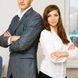 Young man and lady in business style — Stock Photo