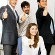 Successful business team showing thumbs up — Stockfoto