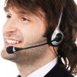 Young businessman with headset — Stock Photo #5726986