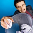 Young businessman playing baskteball with crumpled paper — Stock Photo