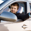 Young man driving a car - Stockfoto