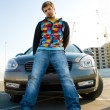 Handsome young man with his car — Stock Photo