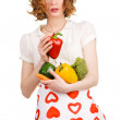 Young beautiful woman holding out a paprika — Stock Photo