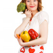 Beautiful housewife with a bunch of fresh vegetables — Stock Photo
