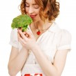 Young beautiful woman holding a broccoli — Stock Photo