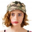 Young woman with smudged makeup an plaster on cheek - Stock Photo