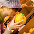 Young woman buying a melon — Stock Photo