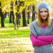 Stock Photo: Young beautiful woman in an autumn park