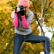 Cute girl taking a photograph — Stock Photo #5727211