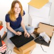Young woman surfing an online store — Stock Photo #5727218