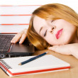 Young woman sleeping at her workplace — Stock Photo