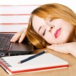 Young woman sleeping at her workplace - Stockfoto