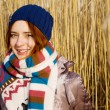Pretty girl in a warm scarf — Stock Photo