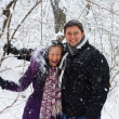 Young couple having fun in winter park — Stock Photo
