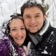 Young happy couple in winter park — Stock Photo #5727440