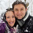 Young happy couple in winter park — Stock Photo