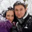 Young sweet couple in winter park — Stock Photo