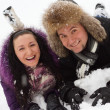 Young joyful couple in winter park — Stock Photo