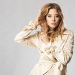 Beautiful fashion model in beige coat — Stock Photo #5727471