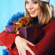Lovely girl with Christmas gift — Stock Photo #5727496