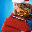 Lovely girl with Christmas gift — Stock Photo