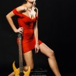 Extravagant model with electric guitar and amplifier — Stock Photo #5727639