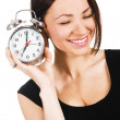 Lovely woman with alarm clock — Stock Photo