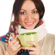 Young beautiful woman with a cup of tea — Stock Photo