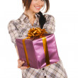 Beautiful young woman with a gift box — Stock Photo