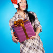 Christmas girl with a gift box - Stock Photo
