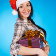 Christmas girl with a gift box — Stock Photo