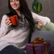 Charming young woman with a gift box — Stock Photo #5727883