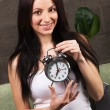 Beautiful woman holding vintage clock — Stock Photo