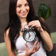 Beautiful woman holding vintage clock — Stock Photo #5727893