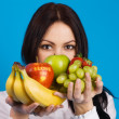 Beautiful young girl with a bunch of fruits — Stock Photo #5728052