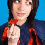Beautiful lady holding a strawberry — Stock Photo #5728066