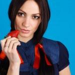 Beautiful lady holding a strawberry — Stock Photo #5728068